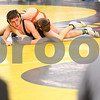 Kyle Bursaw – kbursaw@shawmedia.com<br /> <br /> Sycamore's coaches look on as Colton Burns competes with a Harlem wrestler in a 126-pound match in the Sycamore Invitational on Saturday, Jan. 7, 2012.