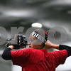Kyle Bursaw – kbursaw@shawmedia.com<br /> <br /> Northern Illinois' Stephanie Tofft winds up a throw during softball practice at the DeKalb Recreation Center on Wednesday, Feb. 22, 2012.