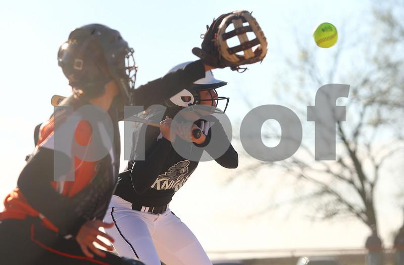 Kyle Bursaw – kbursaw@shawmedia.com<br /> <br /> DeKalb catcher Alysha Guy catches a high pitch behind a Kaneland batter during their game at Huntley Middle School on Thursday, April 5, 2012.