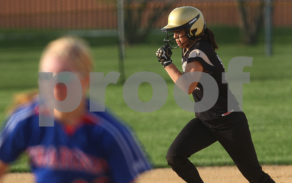 Kyle Bursaw – kbursaw@shawmedia.com<br /> <br /> Sycamore's Jasmyne Taylor (17) makes her way to third base during the game against Dundee-Crown at Sycamore Park on Friday, March 23, 2012.
