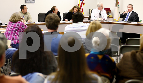 Kyle Bursaw – kbursaw@shawmedia.com<br /> <br /> Hinckley Village President Dan Godhardt (top center) defers to Village Attorney Steve Andersson (top right) to answer a question about the hire of Police Chief Ed Arroyo during the public comment portion of the village board meeting on Monday, March 5, 2012.