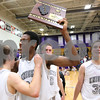 Kyle Bursaw – kbursaw@shawmedia.com<br /> <br /> Marcel Neil holds up the Class 3A Rochelle Regional championship plaque while embracing teammate Drew David. Kaneland defeated Rochelle 65-61at Rochelle Township High School on Friday, March 2, 2012.