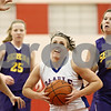 Rob Winner – rwinner@shawmedia.com<br /> <br /> Hinckley-Big Rock's Kaitlin Phillips (14)  drives to the basket in the first quarter during their Little Ten Conference tournament game in Earlville on Thursday.
