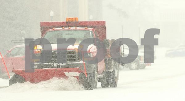 Kyle Bursaw – kbursaw@shawmedia.com<br /> <br /> A plow clears snow on Gilbert Way in in DeKalb, Ill. on Friday, Jan. 20, 2012.