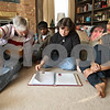 Rob Winner – rwinner@shawmedia.com<br /> <br /> On Saturday afternoon at their DeKalb home, Kevin Ballantine's family including his father Dave Ballantine (from left to right), brother Keerti Ballantine, mother Diane DeMers and sister Pooja Ballantine look over a binder put together for Kevin back in September filled with letters from family, friends and acquaintances about how he made a difference in their lives. Kevin Ballantine, 23, died in January after a long battle with leukemia.