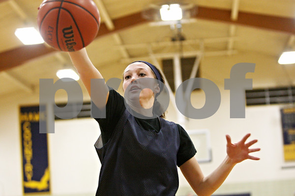 Rob Winner – rwinner@shawmedia.com<br /> <br /> Hiawatha's Dani Clark retrieves a ball during a shooting drill at practice in Kirkland on Wednesday, Jan. 11, 2012.