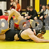 Rob Winner – rwinner@shawmedia.com<br /> <br /> Rock Island's Michael Cole (top) controls Sycamore's Ren Swick during their 170-pound match in a Class 2A Sycamore Team Sectional semifinal on Tuesday, Feb. 21, 2012.