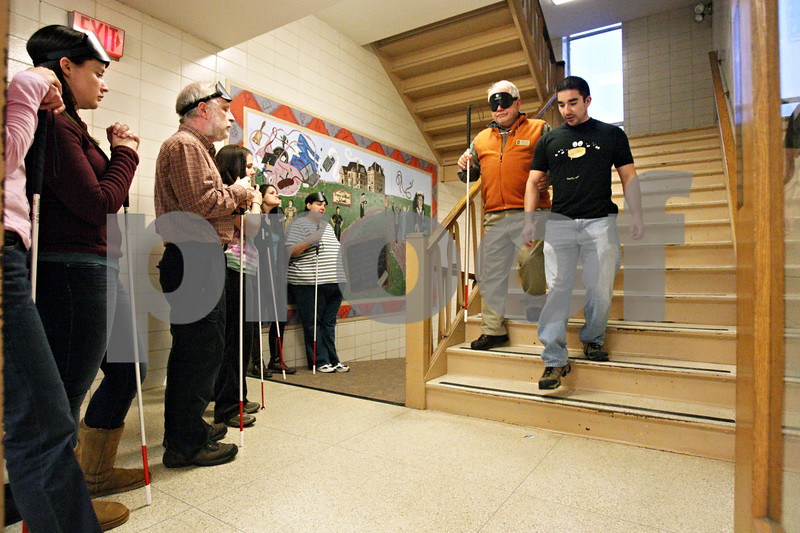 Rob Winner – rwinner@shawmedia.com<br /> <br /> Nathan LaForte (right) leads Dr. William Penrod down a flight of stairs during a mobility and orientation class exercise at Northern Illinois University in DeKalb on Friday. LaForte, a Marine Corps veteran, is now a student at NIU who is focusing on helping rehabilitate veterans who have lost their sight in battle.<br /> <br /> DeKalb. Ill.<br /> Friday, Jan. 27, 2012