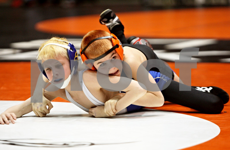 Rob Winner – rwinner@shawmedia.com<br /> <br /> Joe Burris (left), of Porta Junior High School in Petersburg, competes with Justin Hernandez, of Huntley Middle School in DeKalb, during a 65-pound match at the Illinois Elementary School Association wrestling tournament held at the Convocation Center in DeKalb on Saturday.