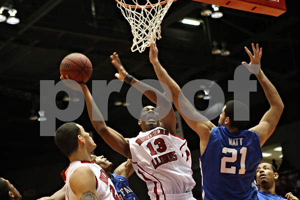 Rob Winner – rwinner@shawmedia.com<br /> <br /> Northern Illinois forward Kevin Gray (13) looks to get a shot over Buffalo forward Mitchell Watt during the second half in DeKalb on Saturday. Buffalo defeated NIU, 74-59.