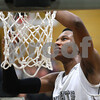 Kyle Bursaw – kbursaw@shawmedia.com<br /> <br /> Kaneland's Marcel Neil cuts down a piece of the net after defeating Rochelle 65-61at Rochelle Township High School on Friday, March 2, 2012. The regional championship is the first for Kaneland under third-year coach Brian Johnson.