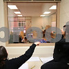 Kyle Bursaw – kbursaw@shawmedia.com<br /> <br /> Deanna Phanenbecker pulls open the blinds on a one-way mirror as she and Darah Contreres (left) get ready to observe and evaluate their peers teaching the youngsters in the Alphabitty Learning Center, a daycare where DeKalb High School students in Tina Holtz's child care occupations classes get to work with children in the community.<br /> <br /> Thursday, Jan. 5, 2012