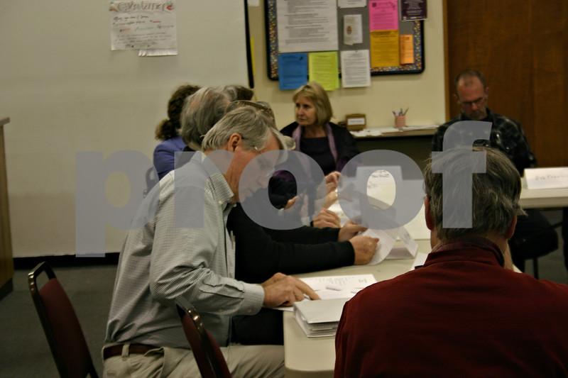 Jeff Engelhardt – jengelhardt@shawmedia.com<br /> Dan Kenney, chairman of Stop the Mega-Dump. prepares his notes for Monday's meeting at Unitarian Universalist Fellowship of DeKalb.