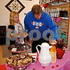 Genoa resident Cary Bergquist and his daughter, Emmajean, 8, sample the chocolate spread at Reflections Hair Salon in Genoa during Saturday's annual Chocolate Walk.<br /> <br /> By Nicole Weskerna - nweskerna@shawmedia.com