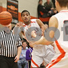 Rob Winner – rwinner@shawmedia.com<br /> <br /> DeKalb's Andre Harris passes to Dan Matya (23) during the second quarter in DeKalb on Friday, Feb. 17, 2012. DeKalb defeated Rochelle, 69-67.
