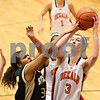 Rob Winner – rwinner@shawmedia.com<br /> <br /> Sycamore's Olyvia Rand (left) fouls DeKalb's Courtney Bemis during the fourth quarter in DeKalb on Thursday, Feb. 9, 2012.