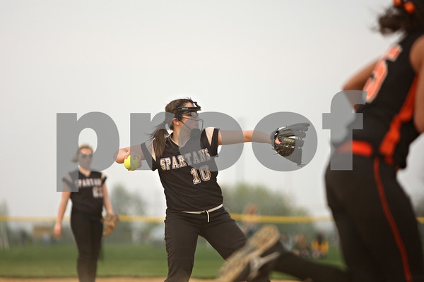 Rob Winner – rwinner@shawmedia.com<br /> <br /> Sycamore pitcher Abby Foulk (10) fields a ground ball off the bat of DeKalb's Hannah Walter (right) and throws to first for the first out during the top of the fourth inning Tuesday in Sycamore. DeKalb defeated Sycamore, 1-0.