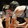Rob Winner – rwinner@shawmedia.com<br /> <br /> DeKalb's Jake Sommer (left) competes with Sycamore's Thomas Ernster during the 138-pound match in DeKalb on Thursday, Jan. 12, 2012.