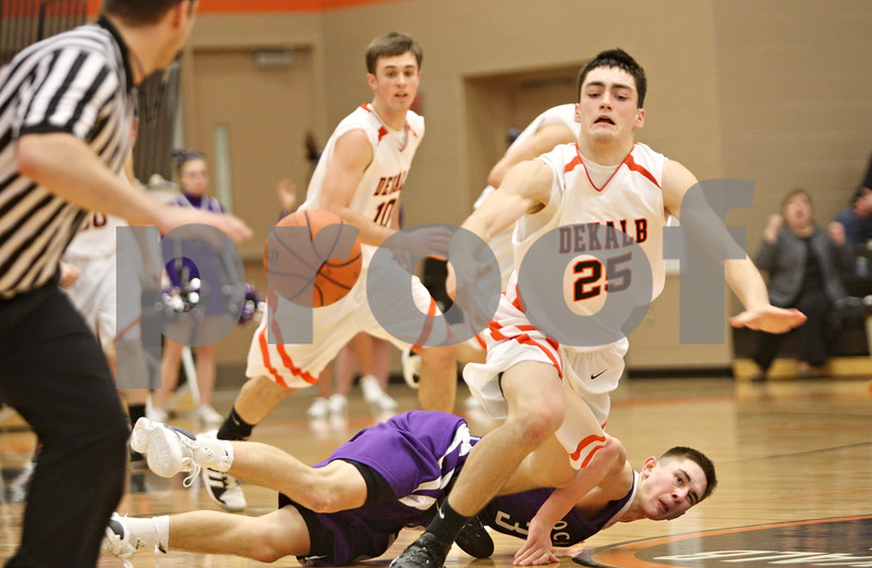 Rob Winner – rwinner@shawmedia.com<br /> <br /> DeKalb's Kyle Berg (25) is fouled from behind by Rochelle's Grant Prusator during the fourth quarter in DeKalb on Friday, Feb. 17, 2012. DeKalb defeated Rochelle, 69-67.