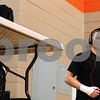 Kyle Bursaw – kbursaw@shawmedia.com<br /> <br /> Kaneland wrestler Dan Goress listens to music before his 138-pound semifinal match at the IHSA DeKalb AA Regional on Saturday, Feb. 4, 2012.