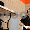 Kyle Bursaw – kbursaw@shawmedia.com<br /> <br /> Kaneland wrestler Dan Goress listens to music before his 138-pound semifinal match at the IHSA DeKalb AA Regional on Saturday, Feb. 4, 2012.