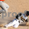 Kyle Bursaw – kbursaw@shawmedia.com<br /> <br /> Sycamore's Davey Scholz slides into third base under a DeKalb player. Scholz was safe and made it in for a run on the same play after the DeKalb player did not make the catch at Sycamore Park on Monday, April 9, 2012. Sycamore defeated DeKalb 15-5.