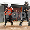 Rob Winner – rwinner@shawmedia.com<br /> <br /> DeKalb baserunner Sabrina Killeen crosses the plate for a run during the bottom of the second inning Friday in DeKalb. DeKalb defeated Streamwood, 10-0, in six innings.