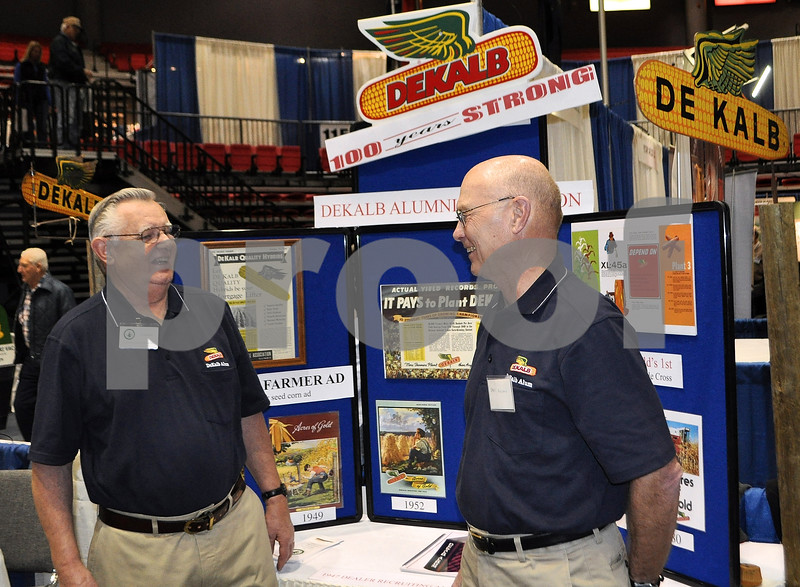 Standing in front of their historical DeKalb Ag Alumni display at the Northern Illinois Farm Show are Al Ratfield (left) and Daryl Rolland.<br /> (Barry Schrader photo)