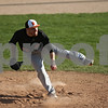 Rob Winner – rwinner@shawmedia.com<br /> <br /> DeKalb's Jeremy Karasewski finishes his delivery on a pitch during the bottom of the third inning Thursday in Sycamore. DeKalb defeated Sycamore, 9-2.