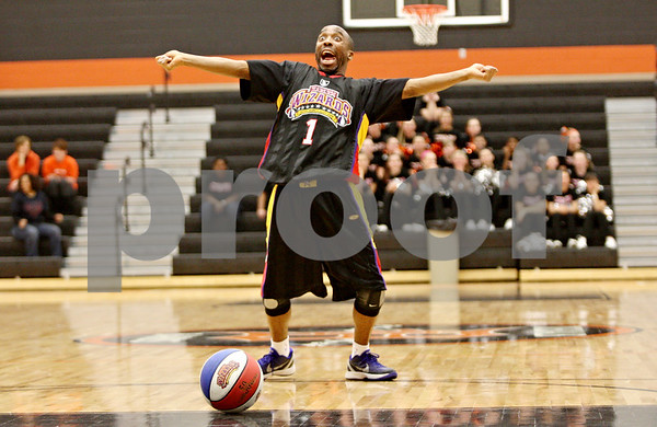 Rob Winner – rwinner@shawmedia.com<br /> <br /> Arthur Lewis, or King Arthur, of the Harlem Wizards dances before a free throw shot during an exhibition at DeKalb High School on Friday night. The game provided a night of family-friendly entertainment and it also served as a fundraiser for Clinton Rosette Middle School.