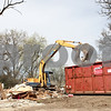 Rob Winner – rwinner@shawmedia.com<br /> <br /> Heavy equipment is used to remove debris after the demolition of a house located at 901 Sycamore Road in DeKalb on Tuesday afternoon.