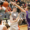 Rob Winner – rwinner@shawmedia.com<br /> <br /> DeKalb's Kyle Berg (25) puts up a shot as Rochelle's David Newton defends during the second quarter in DeKalb on Friday, Feb. 17, 2012. DeKalb defeated Rochelle, 69-67.