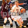 Kyle Bursaw – kbursaw@shawmedia.com<br /> <br /> DeKalb forward James Robinson drives around Elgin defender Kory Brown in the second quarter of the game. Elgin defeated the Barbs 50-48 at DeKalb High School on Tuesday, Feb. 7, 2012.