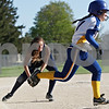 Rob Winner – rwinner@shawmedia.com<br /> <br /> Hiawatha pitcher Ashley Tamraz (left) fields a bunt attempt before throwing out Somonauk baserunner Kendall Herren during the top of the fourth inning Wednesday afternoon in Kirkland. Somonauk scored nine runs in the seventh inning to defeat Hiawatha, 12-6.