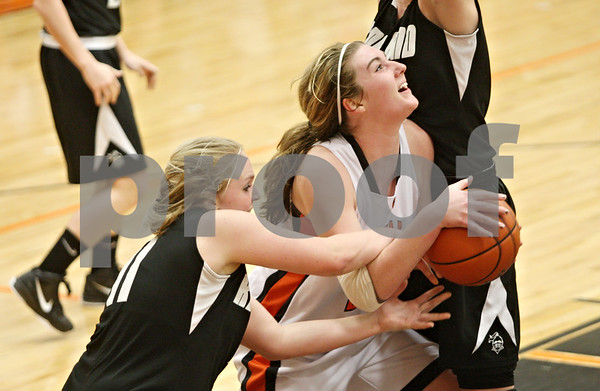 Rob Winner – rwinner@shawmedia.com<br /> <br /> Kaneland's Ashley Prost (left) reaches for a ball controlled by DeKalb's Emily Bemis during the third quarter in DeKalb on Tuesday, Jan. 31, 2012. DeKalb defeated Kaneland, 46-31.
