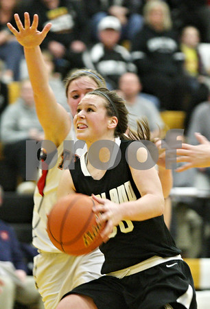 Rob Winner – rwinner@shawmedia.com<br /> <br /> Kaneland's Allyson O'Herron (30) drives to the basket during the second quarter in a Class 3A Sycamore championship on Thursday, Feb. 23, 2012. Belvidere North defeated Kaneland, 43-31.