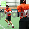 Kyle Bursaw – kbursaw@shawmedia.com<br /> <br /> Northern Illinois quarterback Jordan Lynch does a footwork drill as fellow quarterback Chandler Harnish (12) looks on during practice at the DeKalb Recreation Center on Wednesday, Dec. 14, 2011.