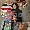 "Rob Winner – rwinner@shawmedia.com<br /> <br /> Kevin Ballantine's family including his father Dave Ballantine (from left to right), mother Diane DeMers, sister Pooja Ballantine and brother Keerti Ballantine are seen in their DeKalb home on Saturday afternoon. Kevin Ballantine, 23, died in January after a long battle with leukemia. Before he passed away, family and friends wrote letters to Ballantine that expressed how he touched their lives, which his mother Diane collected and placed them in a red binder with the words ""Be The Change You Wish To See In The World"" on the cover."