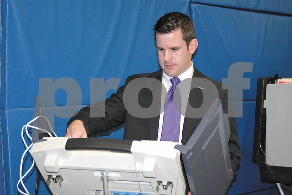Lisa Pesavento/Morris Daily Herald<br /> <br /> Congressman Adam Kinzinger casts his votes on a touchscreen electronic voting machine Tuesday morning at Aux Sable Elementary School in Minooka.