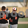 Rob Winner – rwinner@shawmedia.com<br /> <br /> DeKalb catcher Trenton Sopko (9) congratulates Jeremy Karasewski on his complete game Thursday in Sycamore. DeKalb defeated Sycamore, 9-2.