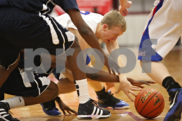 Rob Winner – rwinner@shawmedia.com<br /> <br /> Hinckley-Big Rock's Jared Madden tries to control a loose ball under the Royals' basket in the second quarter of a Class 1A Mooseheart Sectional semifinal on Tuesday night.