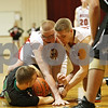 Rob Winner – rwinner@shawmedia.com<br /> <br /> (From left to right) North Boone's James Howe, Indian Creek's Garrison Govig and Jacob Bjorneby struggle over a loose ball under the Timberwolves' basket during the second quarter in Shabbona on Tuesday night.