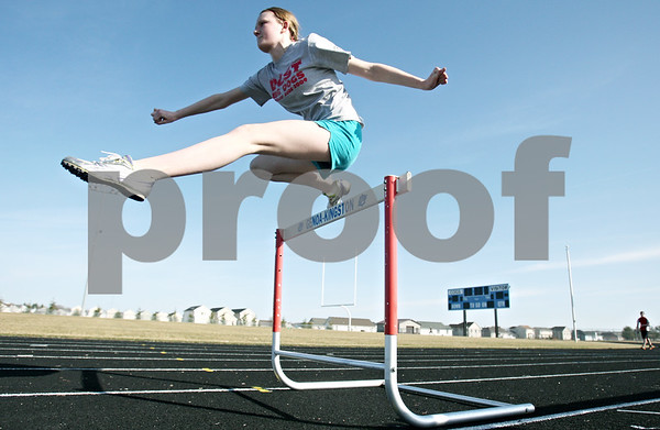 Rob Winner – rwinner@shawmedia.com<br /> <br /> Genoa-Kingston sophomore Brianna Kramer practices hurdles on Tuesday, March 13.