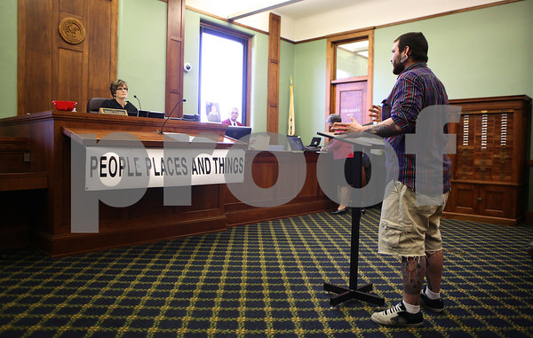 """Kyle Bursaw – kbursaw@shawmedia.com<br /> <br /> Matt Jordan updates drug court Judge Robbin Stuckert on his life and speaks about the weekly drug court quotes on Friday, March 16, 2012. Jordan said he liked both of the quotes for that week which were """"remember it's okay to look back, but don't stare,"""" and """"when you dance with a gorilla it is the gorilla who decides when to stop. Drug court also rotates through three different banners at the front with messages on them."""
