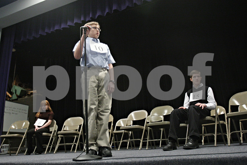 """Rob Winner - rwinner@shawmedia.com<br /> <br /> Keith Mokry, 10 of Somonauk Middle School, looks toward pronouncer Gil Morrison (not pictured) after misspelling the word """"amphibious"""" during the tenth round of the DeKalb County Spelling Bee at Kishwaukee College on Saturday, Feb. 25, 2012. Mokry finished in third place."""