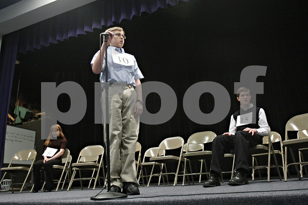 "Rob Winner - rwinner@shawmedia.com<br /> <br /> Keith Mokry, 10 of Somonauk Middle School, looks toward pronouncer Gil Morrison (not pictured) after misspelling the word ""amphibious"" during the tenth round of the DeKalb County Spelling Bee at Kishwaukee College on Saturday, Feb. 25, 2012. Mokry finished in third place."
