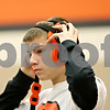 Rob Winner – rwinner@shawmedia.com<br /> <br /> DeKalb's Jackson Montgomery puts on his headgear before his 106-pound match against Propect's Sam Lobono during the Don Flavin Tournament on Friday, Dec. 30, 2011, in DeKalb, Ill.