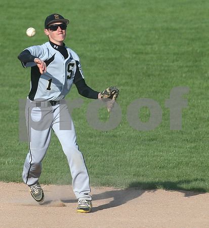 Kyle Bursaw – kbursaw@shawmedia.com <br /> <br /> Sycamore's Fred Beltrame throws to first base during Sycamore's 6-2 loss to DeKalb at Huntley Middle School on Tuesday, April 10, 2012.