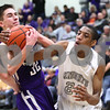 Kyle Bursaw – kbursaw@shawmedia.com<br /> <br /> Rochelle guard Grant Prusator and Kaneland guard Thomas Williams battle for a rebound late in the fourth quarter.<br /> Kaneland defeated Rochelle 65-61at Rochelle Township High School on Friday, March 2, 2012. The regional championship is the first for Kaneland under third-year coach Brian Johnson.