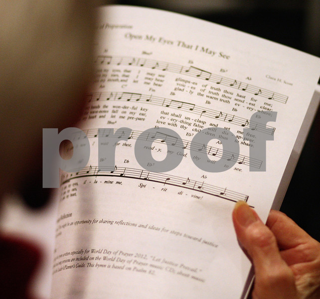 Kyle Bursaw – kbursaw@shawmedia.com<br /> <br /> A woman looks over a hymn in the program before the start of the World Day of Prayer ceremony at the Salvation Army in DeKalb, Ill. on Friday, March 2, 2012.